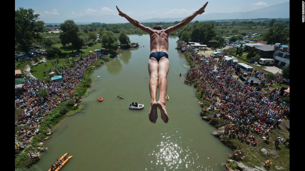Sali Riza Grancina performs his winning dive as he jumps from the Ura e Shenjte bridge, 72 feet in the air, into the Drini i Bardhe river near Gjakova, Kosovo, on Sunday, August 10. There were 27 divers from Kosovo competing in the annual high-diving competition.