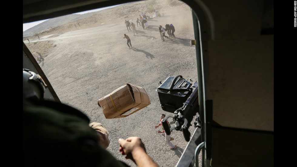 "A CNN crew was on the flight, which took diapers, milk, water and food to the site. Thousands of people have been fleeing from the militant group ISIS, which has <a href=""http://www.cnn.com/2014/06/13/world/gallery/iraq-under-siege/index.html"">taken over large swaths of northern and western Iraq</a> as it seeks to create an Islamic caliphate that stretches from Syria into Iraq."