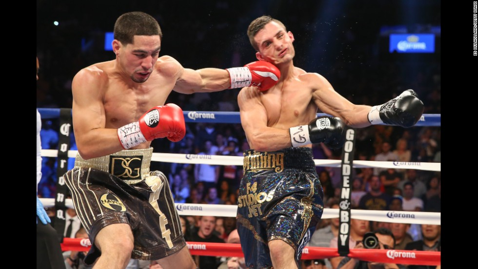 Light-welterweight boxing champion Danny Garcia lands a left hook to the head of Rod Salka during their bout Saturday, August 9, in Brooklyn, New York. Garcia's second-round knockout improved his professional record to 29-0.