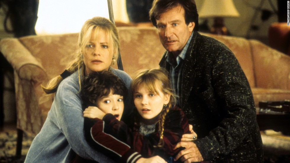 "From left, Bonnie Hunt, Bradley Pierce, Kirsten Dunst and Williams hold one another in a scene from the 1995 film ""Jumanji."""