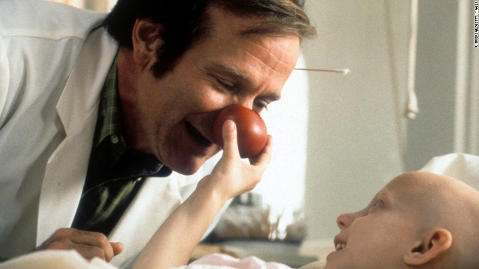 "Williams visits a sick child in a scene from the film ""Patch Adams"" in 1998."