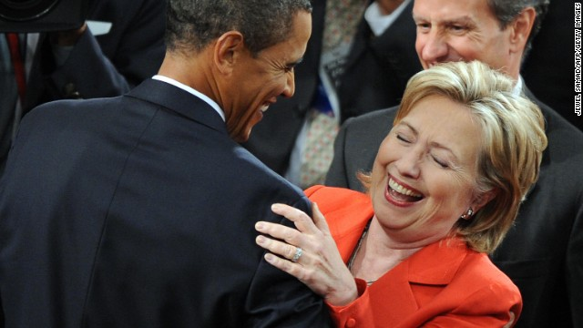 US President Barack Obama shares a laugh with Secretary of State Hillary Clinton as he arrives to address a joint session of Congress on his embattled healthcare reform plan at the US Capitol in Washington, DC, on September 9, 2009. Obama, whose approval ratings have taken a hit, hopes to regain control of healthcare reform, one of his top legislative priorities. AFP PHOTO/Jewel SAMAD (Photo credit should read JEWEL SAMAD/AFP/Getty Images)