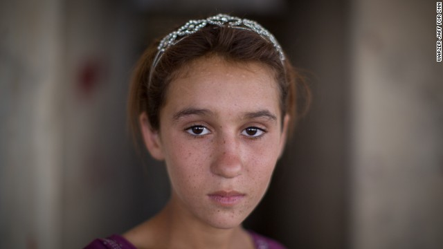 Aziza Hamid, 15, was rescued from Mount Sinjar and now lives in a derelict building that houses more than a thousand other refugees.