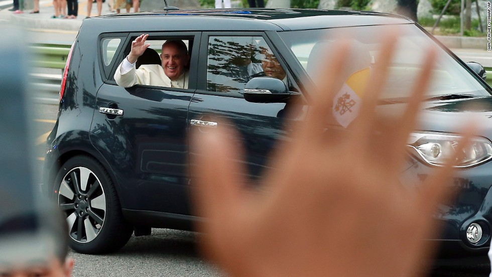 Pope Francis waves to a crowd after his arrival in Seongnam, South Korea, on August 14.