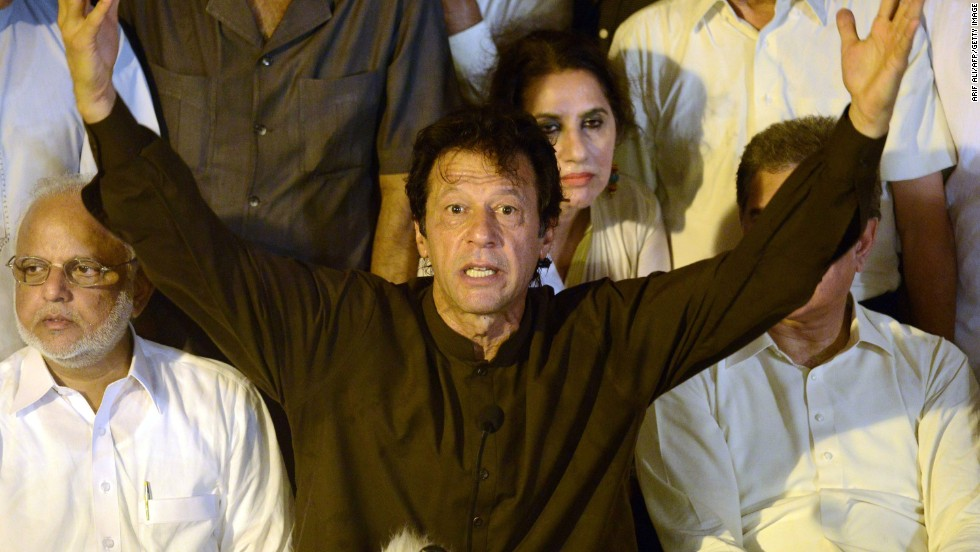 Cricketer-turned politician Imran Khan (C) appeals to supporters as he speaks with the media in Lahore on August 12.
