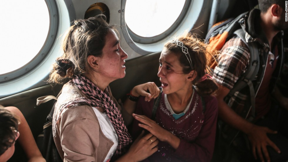 "Aziza Hamid, a 15-year-old Iraqi girl, cries for her father while she and some other Yazidi people are flown to safety Monday, August 11, after a <a href=""http://www.cnn.com/2014/08/11/world/gallery/kurdistan-rescue-mission-mount-sinjar/index.html"">dramatic rescue operation</a> at Iraq's Mount Sinjar. A CNN crew <a href=""http://www.cnn.com/2014/08/11/world/meast/iraq-rescue-mission/index.html"">was on the flight,</a> which took diapers, milk, water and food to the site where as many as 70,000 people remain trapped by the militant group ISIS. But only a few of them were able to fly back on the helicopter with the Iraqi Air Force and Kurdish Peshmerga fighters."