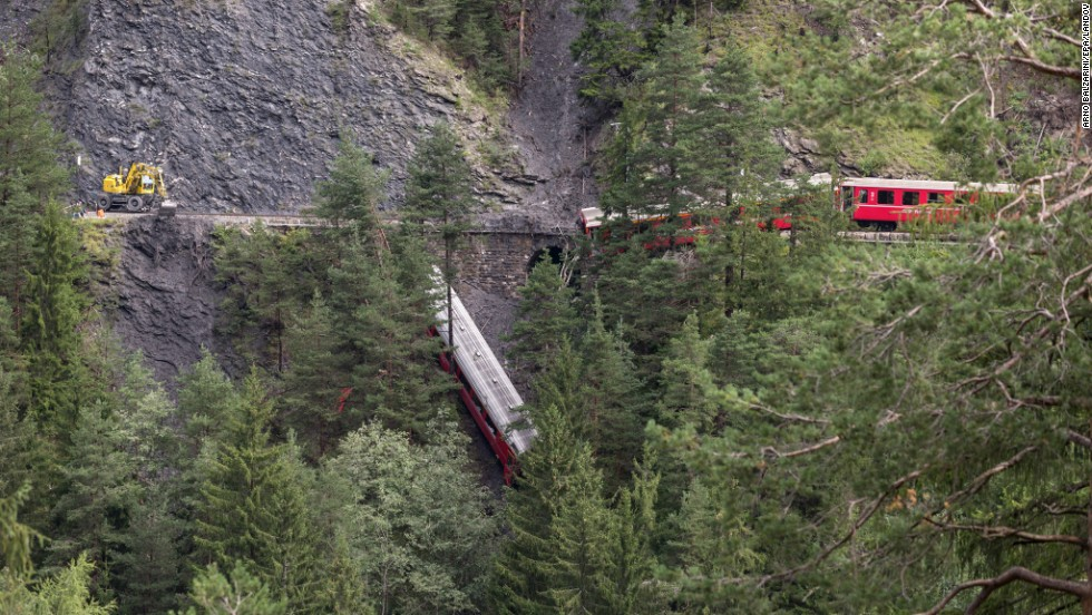 "A derailed passenger train is seen near Tiefencastel, Switzerland, on Wednesday, August 13. A landslide caused the train to <a href=""http://www.cnn.com/2014/08/13/world/gallery/switzerland-train-derailment/index.html"">partially derail</a> in the Swiss Alps, injuring at least six people, regional police spokesman Peter Faerber said."