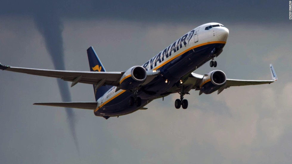 <strong>August 14:</strong> A Ryanair commercial jet takes off from East Midlands Airport in Derby, England, as a tornado funnel forms nearby.