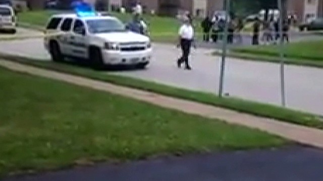 nd ferguson cell phone video mike brown body on ground_00024907.jpg