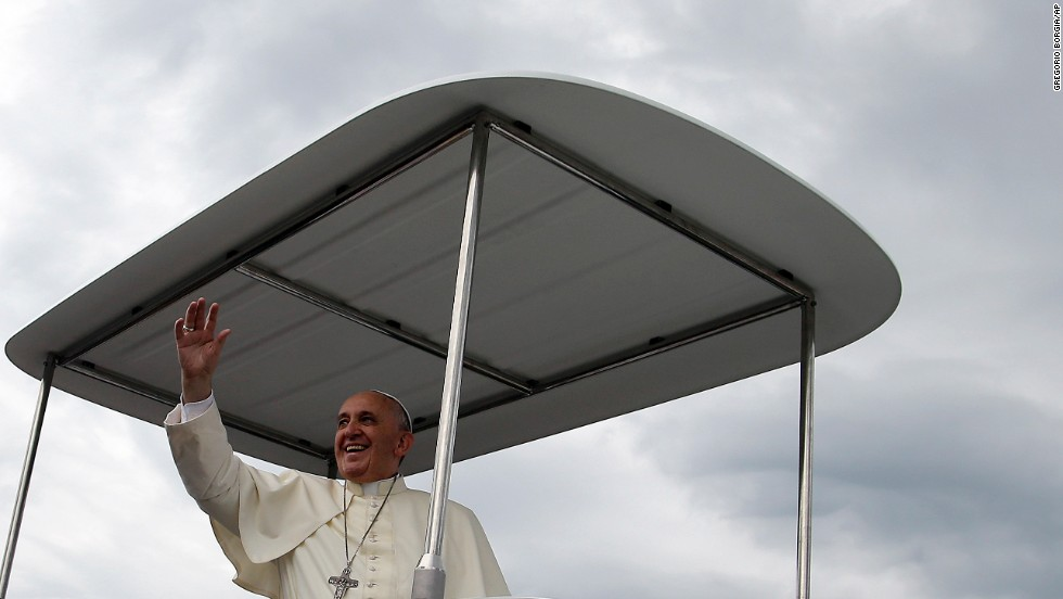 Pope Francis blesses the faithful on August 17 as he arrives for Mass.