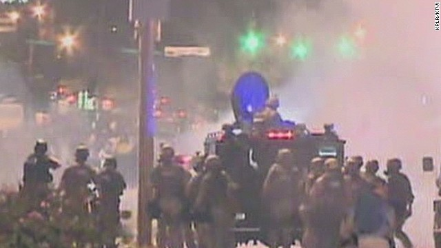 Police fire tear gas at Ferguson protesters
