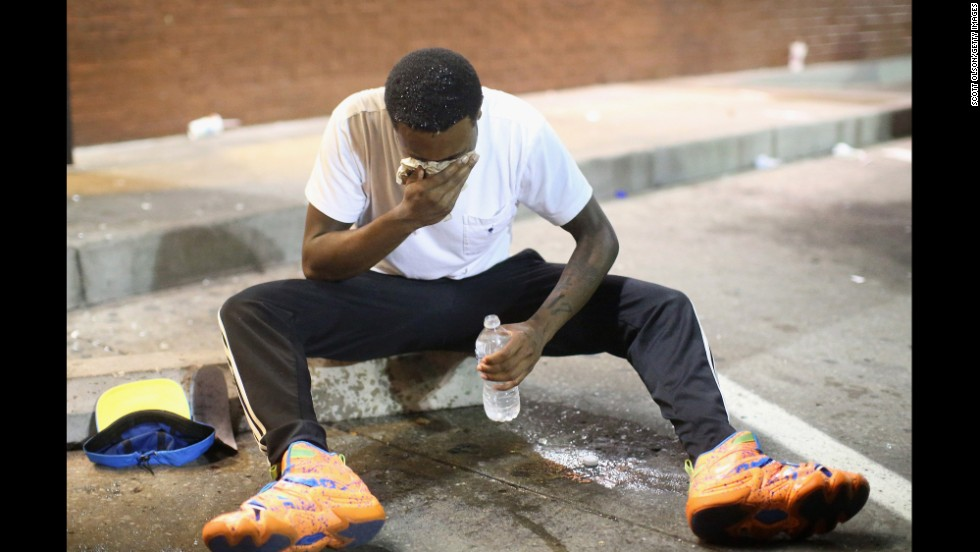 A man fights the effects of tear gas in Ferguson on August 17, 2014.