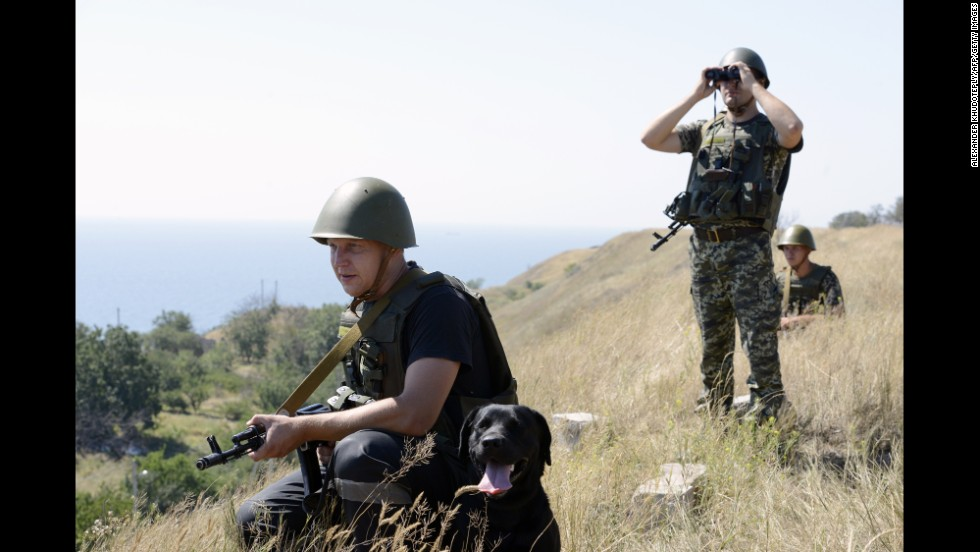 Ukrainian border guards patrol near Novoazovsk on Friday, August 15.