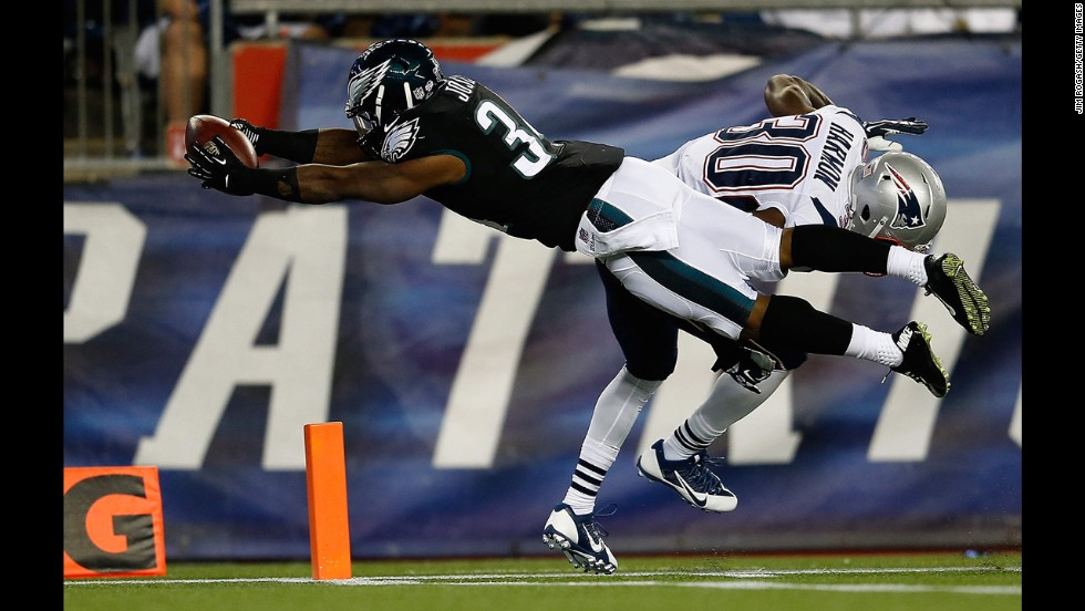 Philadelphia Eagles running back Henry Josey scores a touchdown in an NFL preseason game against the New England Patriots on Friday, August 15, in Foxborough, Massachusetts.