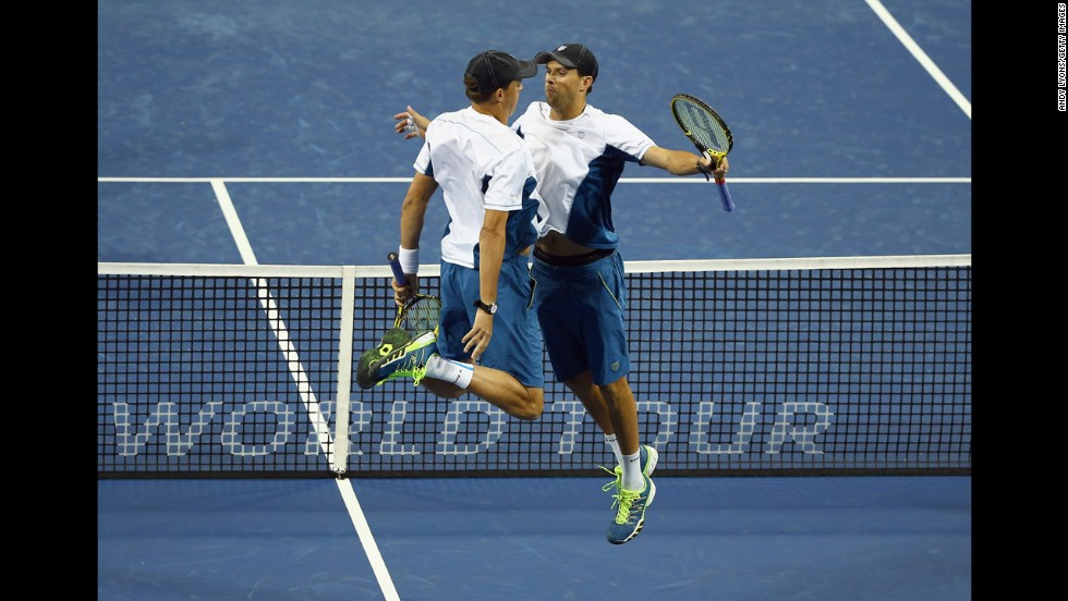 The Bryan brothers, Bob and Mike, bump chests Thursday, August 14, after defeating the doubles team of Eric Butorac and Raven Klaasen at the Western & Southern Open in Cincinnati. The Bryans would go on to win the doubles final several days later.