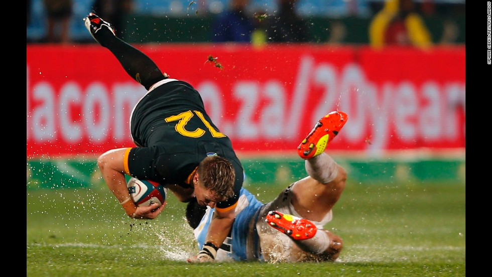 Argentina's Juan Martin, right, tackles South African captain Jean de Villiers during their Rugby Championship match Saturday, August 16, in Pretoria, South Africa. South Africa won 13-6 in what was the opening match for both teams.