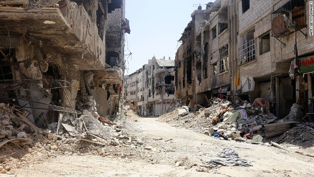 THIS PICTURE WAS TAKEN ON A GOVERNMENT-GUIDED TOUR. A picture taken on August 15, 2014, shows a general view of damaged buildings in Mleiha on the outskirts of the capital Damascus. Syrian government forces retook the key town southeast of the capital on August 14, after a months-long battle against rebels, a military source and state television said. AFP PHOTO/LOUAI BESHARALOUAI BESHARA/AFP/Getty Images