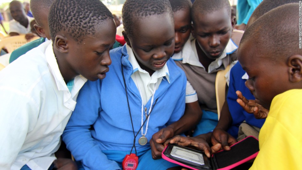 E-readers are still something of a novelty in some remote areas of Kenya. Students gather around a device in Amogoro, a town near the country's western border.