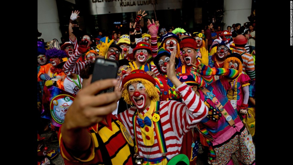 Clowns pose for a selfie during the Clown Festival in Kuala Lumpur, Malaysia, on Sunday, August 17. About 80 clowns from all over Malaysia took part in the event to provide a platform for clown education.