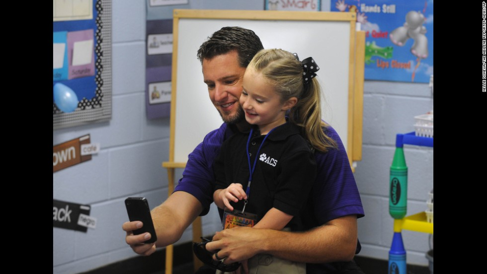 Cory Driskill gets a selfie with his daughter, Addie, on her first day of kindergarten Thursday, August 14, in Abilene, Texas.