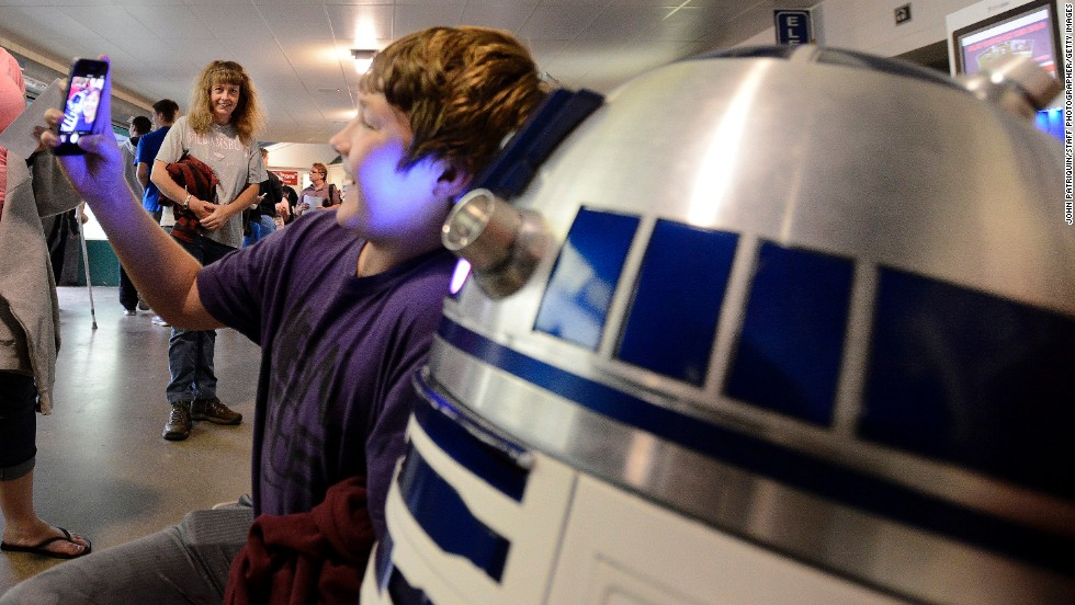 "Cameron Jackson takes a selfie with an R2-D2 replica on Saturday, August 16, as the Portland Sea Dogs, a minor-league baseball team from Portland, Maine, hosted a promotional ""Star Wars"" Night."