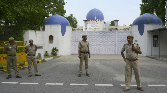 Indian policemen stand guard outside the High Commission for Pakistan in New Delhi on August 18, 2014.