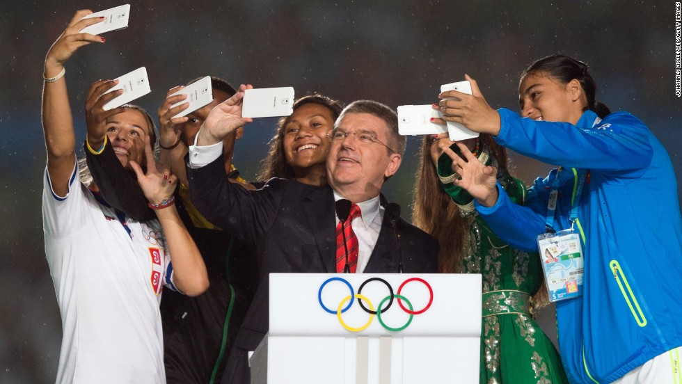 Thomas Bach, president of the International Olympic Committee, snaps a selfie along with some athletes on Saturday, August 16, during the opening ceremony for the Youth Olympic Games in Nanjing, China.