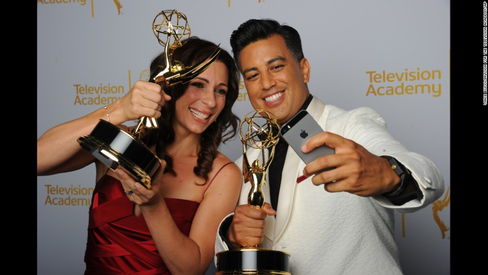 "Choreographers Tabitha D'umo and her husband, Napoleon, pose Saturday, August 16, with the Creative Arts Emmys they won for their work on the television show ""So You Think You Can Dance."""