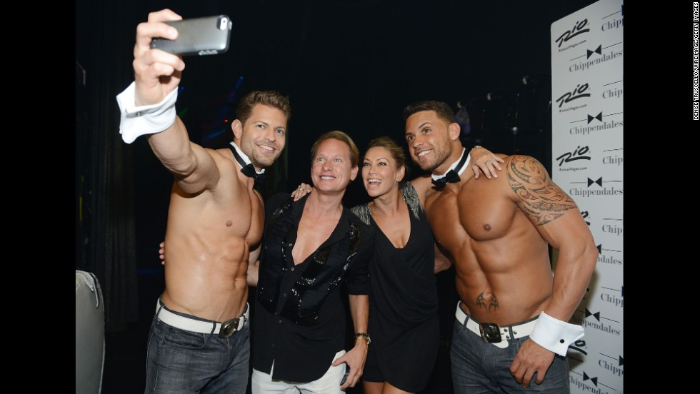 Television personality Carson Kressley and professional dancer Kym Johnson are flanked by two dancers backstage at a Chippendales show in Las Vegas on Sunday, August 17.