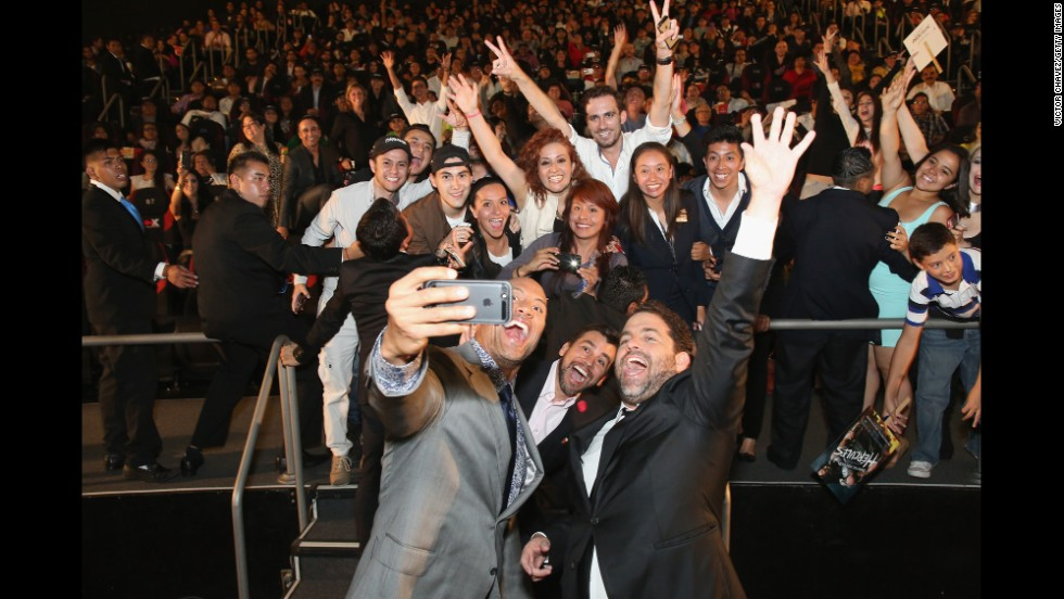 "Actor Dwayne Johnson takes a photo with fans and director Brett Ratner, right, at the Latin American premiere of ""Hercules"" on Monday, August 18, in Mexico City. <a href=""http://www.cnn.com/2014/08/13/world/gallery/look-at-me-0813/index.html"">See 20 selfies from last week</a>"