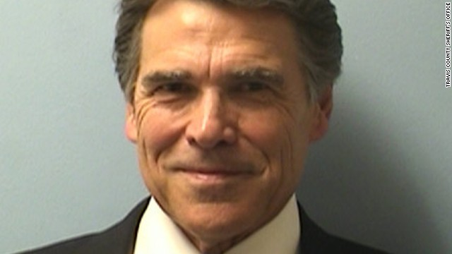 Texas Gov. Rick Perry was booked on Tuesday on two felony charges related to his handling of a local political controversy.