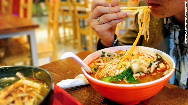A woman lunches on a bowl of soup noodles at a food court in Beijing on April 6, 2011. The Asian Development Bank on April 6 said controlling inflation was the 'top priority' for the region as strong growth, turmoil in the Middle East and Japan's nuclear crisis drive up oil prices while food costs across the region hit record highs in February.
