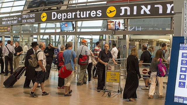 Passengers gather at the departure gate at Ben Gurion International airport, near the Mediterranean Israeli coastal city of Tel Aviv on August 21, 2014, following a warning issued by Hamas's armed wing that they will target the airport from 6 am (0300 GMT) in a bid to disrupt air traffic. Ofer Lefler, spokesman for the Israel Airports Authority (IAA), told AFP flights had been disrupted for a brief 10 minute pause but aside from that, everything was operating normally. AFP PHOTO / JACK GUEZJACK GUEZ/AFP/Getty Images