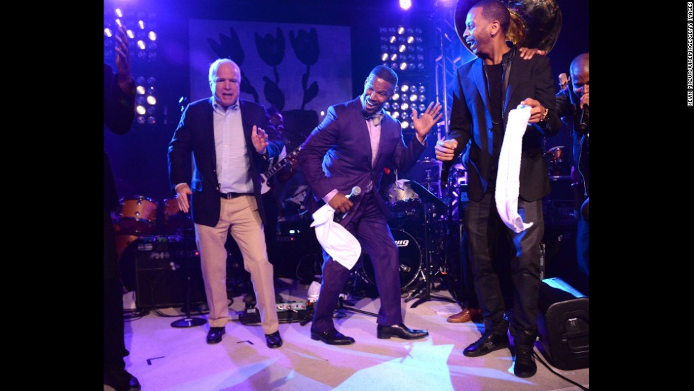 U.S. Sen. John McCain, left, dances on stage with actor and musician Jamie Foxx, center, at the Apollo in the Hamptons benefit Saturday, August 16, in East Hampton, New York.