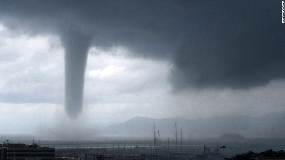 A tornado is seen approaching the coastal city of Genoa, Italy, on Tuesday, August 19. At right, in the background, is the wreckage of the Costa Concordia cruise ship, which was towed recently to Genoa so it could be scrapped.