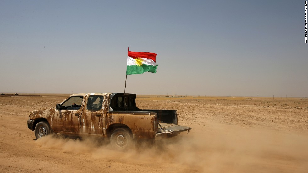 "Kurdish Peshmerga forces drive a vehicle near the Iraqi town of Makhmur, south of Irbil, after ISIS militants withdrew on Monday, August 18. ISIS has <a href=""http://www.cnn.com/2014/06/13/world/gallery/iraq-under-siege/index.html"">taken over large swaths of northern and western Iraq</a> as it seeks to create an Islamic caliphate that stretches from Syria to Iraq."