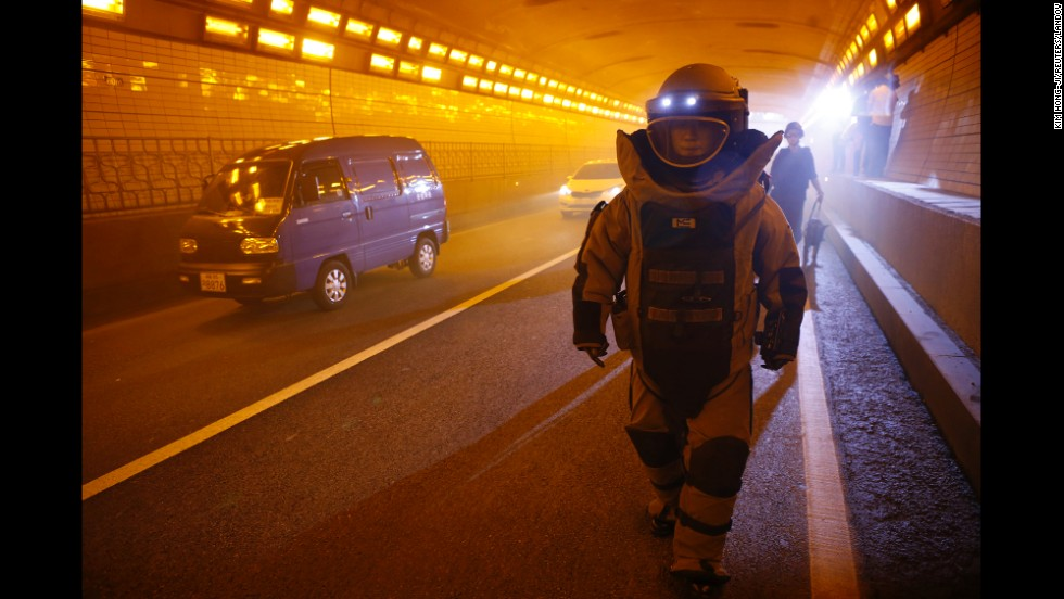 A SWAT team member wearing a bomb suit takes part in an anti-terror drill in Seoul, South Korea, on Monday, August 18.