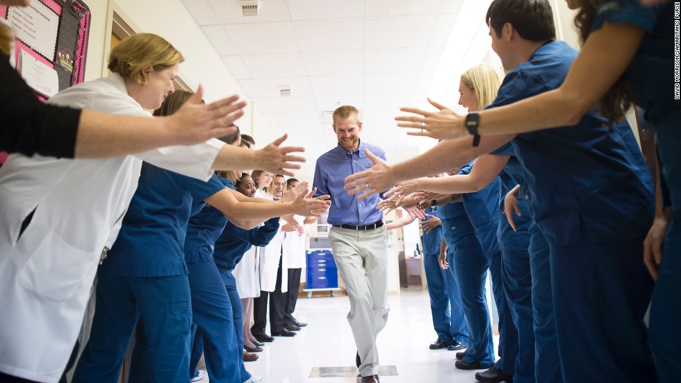 Ebola survivor Dr. Kent Brantly leaves Emory University Hospital after being released from treatment in Atlanta on Thursday, August 21. Brantly was one of two American missionaries brought to Emory for treatment of the deadly virus.