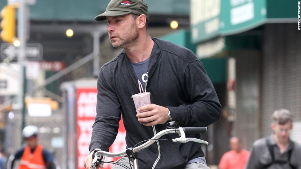 Liev Schreiber uses a bike to run some errands in New York City on August 21.