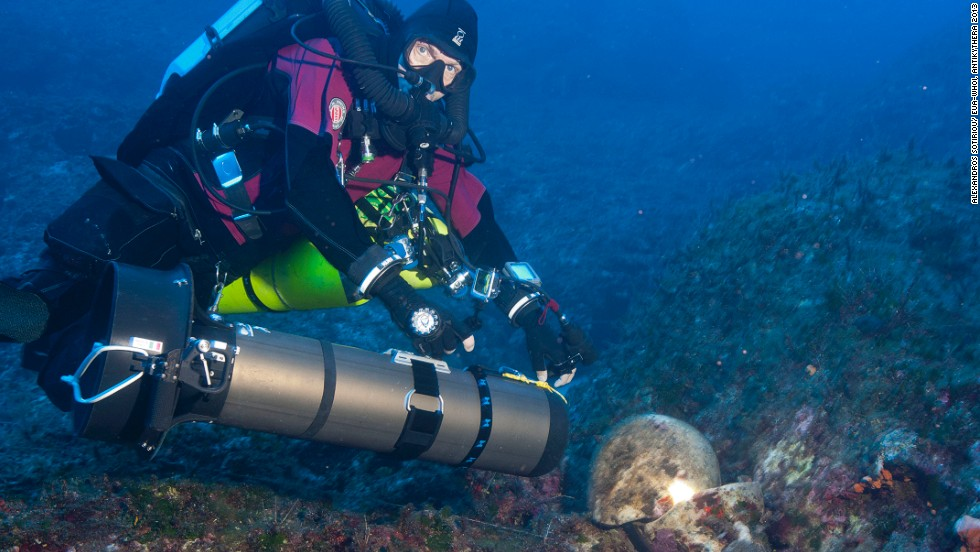 "Foley said: ""It's actually a treasure ship and there are just no two ways about it. There are 36, 38 statues of marble and bronze, gold jewelry, very high quality glass artifacts that came from the East Mediterranean. Just the highest quality stuff that was available in the first and second centuries BC."" Pictured, technical diver Phillip Short inspects an amphora on a previous reconnaissance dive."