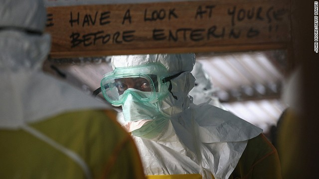 A member of Doctors Without Borders (MSF) prior to entering a high-risk area of an Ebola treatment center.