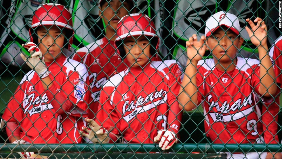 Members of Team Japan look on from the dugout during the fifth inning of their 12-3 loss to Team Asia-Pacific on August 23.