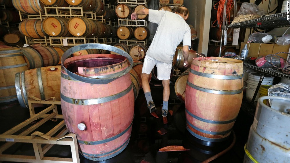 Winemaker Tom Montgomery walks through spilled wine to see the damage at the B.R. Cohn Winery barrel storage facility on August 24 in Napa.