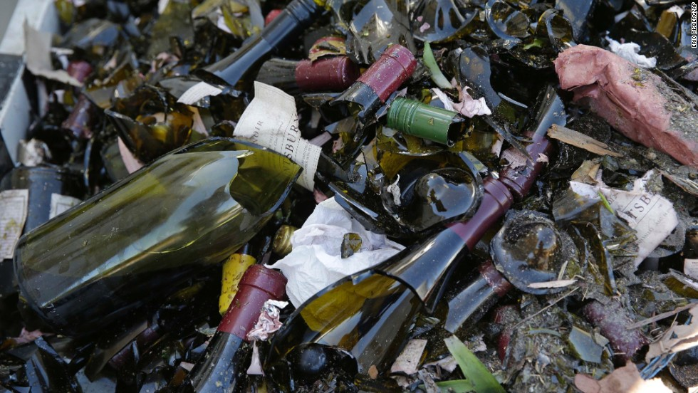 Broken bottles from the library wines of the Saintsbury winery are tossed in a grape bin on August 24 after the earthquake.