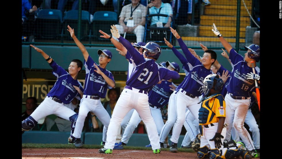 South Korea's Hae Chan-choi, No.  21, celebrates with teammates after hitting a two-run home run off Chicago's Brandon Green in the sixth inning on August 24.