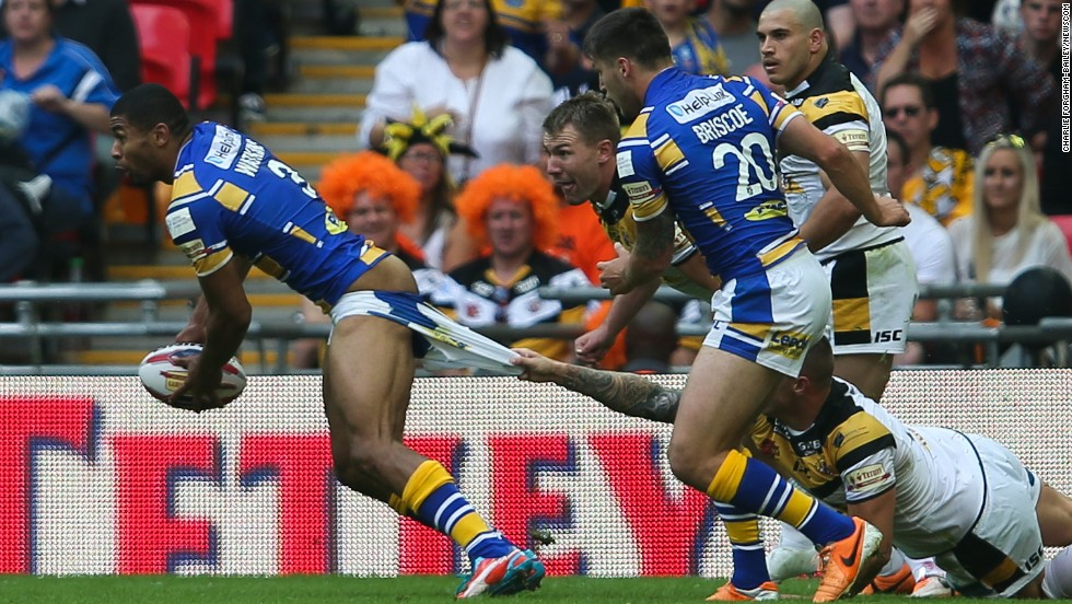 Leeds Rhinos' Kallum Watkins has his shorts pulled down during the Tetley's Challenge Cup Final against the Castleford Tigers on Saturday, August 23, at Wembley Stadium in London. Leeds won 23-10.