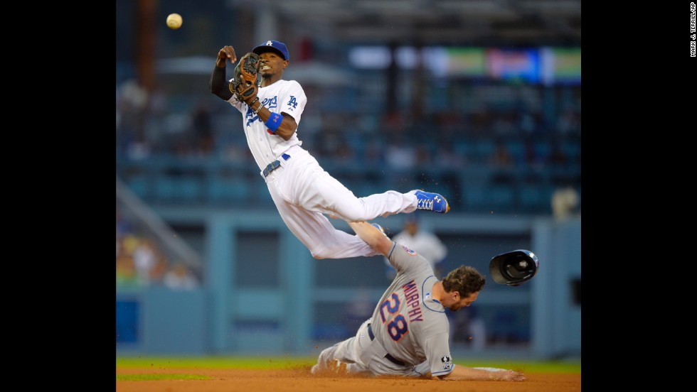 New York Mets' Daniel Murphy is forced out at second as Los Angeles Dodgers second baseman Dee Gordon throws out David Wright during the fifth inning on Saturday, August 23, in Los Angeles. The Dodgers won 7-4.