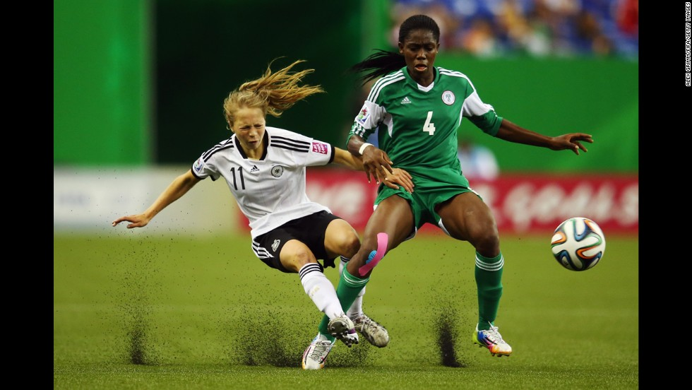 Theresa Panfil of Germany, left, is challenged by Asisat Oshoala of Nigeria during the FIFA U-20 Women's World Cup Canada on Sunday, August 24, in Montreal. Germany beat Nigeria 1-0.