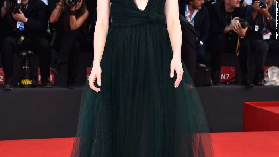 Emma Stone brings an elegant look to the Venice Film Festival on August 27.