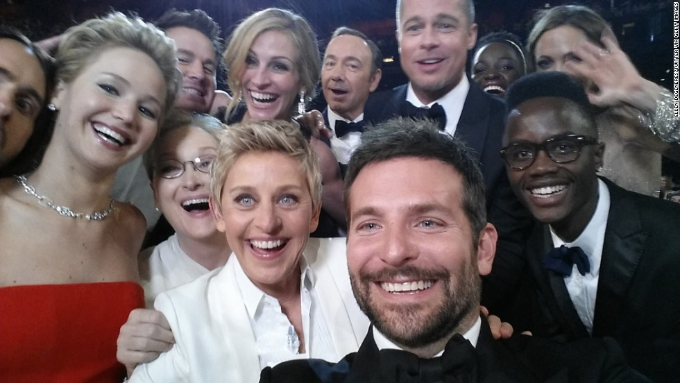 Pitt and Jolie (upper right) appear in  a mass selfie with other movie stars during the Academy Awards in March.